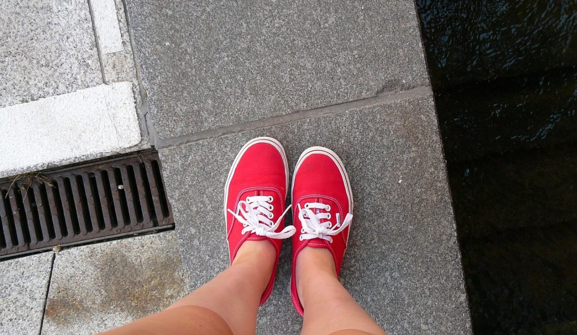 legs and red sneakers