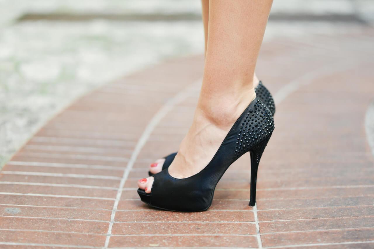 standing in high heels